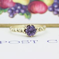 Shimmering between shades of purple and smoky blue this dainty Victorian simulated alexandrite ring is perfect for either stacking or as a one of a kind engagement ring! You can spot it in our Non-Traditional Bridal section now; see our bio for the link!  #junebaby #fergusonsfinejewelry