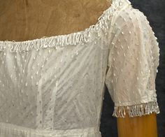 French beaded cotton evening dress, c.1805 Made from white cotton muslin, the peerless Directoire dress is totally covered with opaque white Bohemian glass bugle beads. The neckline and sleeves are bordered with loops of beads. Such a simple high style gown could have been worn by a wealthy, aristocratic Russian girl to her first grand ball.