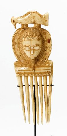 Africa | Comb from the Baule people of the Ivory Coast | Hippo tooth ivory
