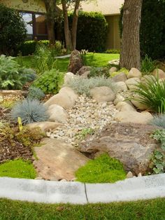 Enhance Scenery at Home Through Boulder Landscape Design - I like this except for the concrete edging, I like to imitate nature and this concrete edging looks very obviously fake.