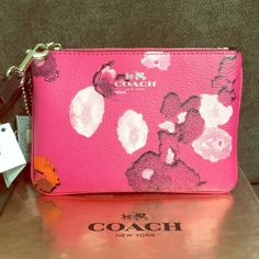 """COACH Floral Print Small Wristlet Pink Multicolor Floral print canvas, 2 card pockets, zip top closure, fabric lining, strap with clip to form a wrist strap or attach to the inside of a bag, 6 1/4"""" L x 4 1/4"""" H Coach Bags Clutches & Wristlets"""