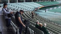 Tim McCormick, Shaun Herbertson and Ben Steel filming at the MCG. Photo by Sally McLean World Famous, Sally, Documentaries, Champion, Waves, Steel, History, Historia, Ocean Waves