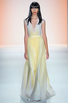 Jenny Packham Spring 2012 collection. Soft pale yellow gets romantic in this delicate lace-capped sleeve v-neck gown. Sweet!