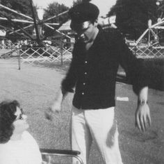 This picture of Elvis and a fan was taken at the Memphis Fairgrounds on Saturday, July 21,1962. See another picture in color here: https://de.pinterest.com/pin/380906080960353779/