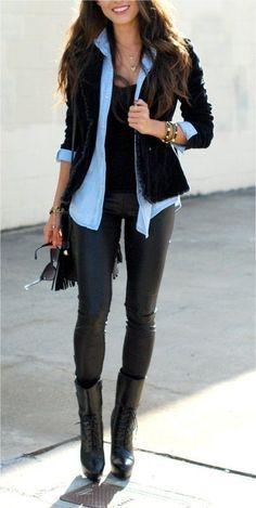 Black vest, denim shirt, black pants, patterned top or scarf