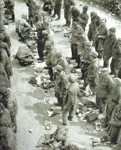 Pin by Paolo Marzioli - German POWs lining up and waiting for MPs to inspect the personal belongings piled up at their feet. Consisting of Fallschirmjäger, Panzer Grenadiers of the 17th SS-Panzergrenadier Division Götz von Berlichingen as well as a Fallschirmpanzer Div....