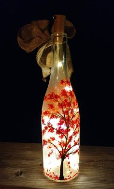 Hand Painted Autumn Tree with Falling Leaves Painted Glass Bottles, Recycled Glass Bottles, Glass Bottle Crafts, Wine Bottle Art, Lighted Wine Bottles, Diy Bottle, Led Bottle Light, Pottery Painting Designs, Bottle Painting