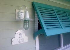 Great idea for our back living room window now that we opened up the room and gained awesome light, but that sometimes blinds you! Shutters to provide shade over half the window.nice color too Coastal Homes, Coastal Decor, Exterior Colors, Exterior Paint, Bahama Shutters, Window Awnings, Tropical, Florida Home, Beach House Decor