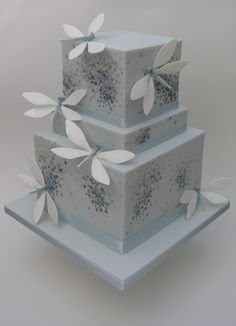 The glowing tiers of this wedding cake appear to be lit from within. Very clever painting by Rosalind Miller.