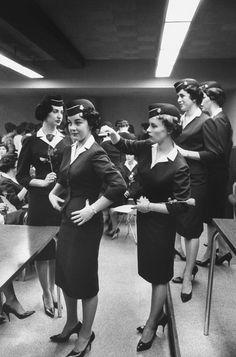 In this 1961 photo, the women prepare to graduate flight attendant school