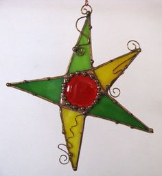 Stained glass and copper star suncatcher light catcher ornament yellow green orange. $24.00, via Etsy.