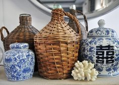 Blue and white ginger jars + wicker demijohns