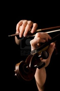 Female hands play a violin on black Stock Photo