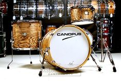 Canopus Ash 3pc Drum Set w/ Tom Stand Canopus Ash 3pc Rock Drum Set : 20x15 bass drum; 12x8 tom; 16x15 floor tom. Single tom stand included. Natural Grain Ash oil finish. This kit was on display at the 2015 NAMM show, and shows some wear on the heads. Purchase Here: http://www.drumcenternh.com/canopus-ash-3pc-drum-set-w-tom-stand.html