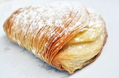 Sfogliatella.  I must have had at least a thousand of these when I was a teenage girl.  I would eat them every Sunday for breakfast!  My Mom would get them from an Italian bakery when they were still warm!!