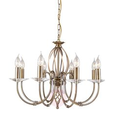 A classic style 8 light chandelier in an aged brass finish with cut glass sconces. Wheel Chandelier, Rectangle Chandelier, Chandelier Lighting, Cut Glass, Clear Glass, Chandeliers, Lounge Lighting, Nickel Plating, Semi Flush Ceiling Lights