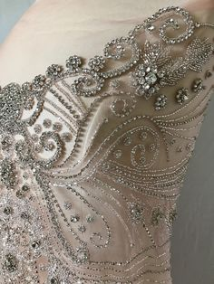 Blushing! The perfect rhinestone appliqué in beautiful blush tulle and adorned with glamorous rhinestones!