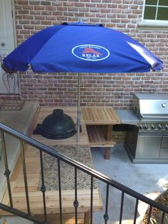 Big Green Egg has a new home! (like how everything is low, sit by the cooking area)