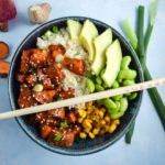 "Recipe for teriyaki cauliflower rice bowls, made with sweet potatoes, edamame, corn, avocado, and coconut-scented cauliflower ""rice"". Vegetarian and vegan."