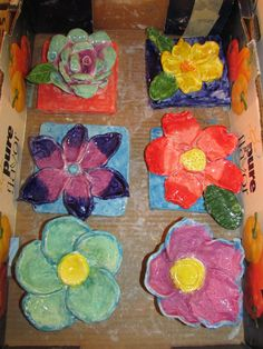 """ceramic flower sculptures by 2nd and 3rd grade students; approx. 7"""" X 7""""; lesson by art teacher: Susan Joe"""