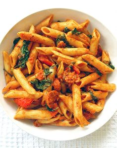 Spinach And Chorizo Red Pesto Penne. A healthy pasta dish with spinach, tomatoes and chorizo, smothered in a flavourful red pesto sauce. On the table in 20 minutes!
