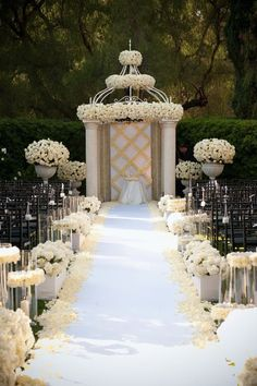 When it comes to weddings, sometimes drama is a good thing! This over-the-top white rose ceremony space is one of those times; the flowers make such a mesmerizing statement, your kid cousins will forget to fight over who throws the petals down the aisle.  | 10 Ideas for White Rose Wedding Flowers for Your Ceremony and Reception