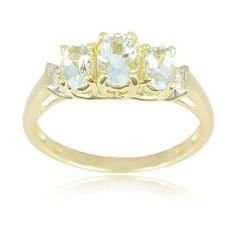 Colorful brilliance classic style10k yellow gold march birthstone 3-stone aquamarine with diamond-accent ring. The style is simple, tasteful and beautiful.