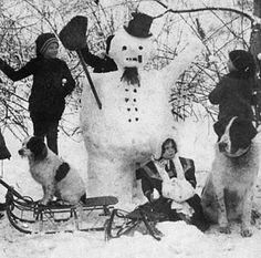 """We actually own this photo at """"The History of the Snowman"""" http://www.historyofthesnowman.com/  Love the Newfoundland dog and the snowman with legs!"""