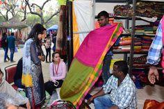 Visitors buying Gadwal saris from Telangana at Surajkund International Crafts Mela! International Craft, Stalls, Sari, Crafts, Fashion, Saree, Moda, Manualidades, Fashion Styles
