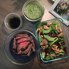 While30 day 25 breakfast: I had a small piece of steak leftover from dinner a few nights ago so I sliced it and am putting it on a salad of mixed greens dried cranberries walnuts and chopped dried figs with a dressing of balsamic vinegar olive oil salt and pepper. Plus a glass of Suja green juice. I keep the steak separate from the salad until after I heat it.  #top_whole30 by thrivingonpaleo