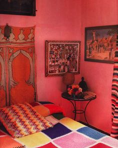Cute wall color, and I am diggin that tapestry headboard! Groovy!