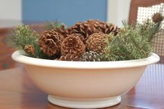 Ironstone wash bowl filled with pine cones and greenery from Miss Mustard Seed.