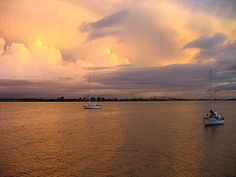 Sunset above Suriname river at the pier of Hotel Torarica