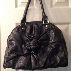 Handbag Black Deux Lux handbag (soft faux leather) Knot design in the front, one inside zipper and gold hardware. Bottom feet also gold. It's been sitting in my closet so it's a little smushed other than that clean and good condition.  Carried for a short time. Deux Lux Bags