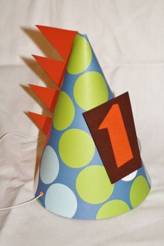 Featured in Parenting magazine - Dinomite Dinosaur Party Hat. $7.25, via Etsy.