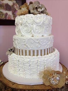 Rustic wedding cake! Burlap :)