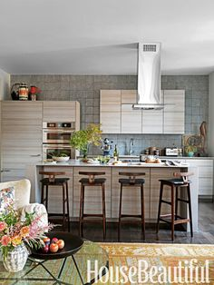 Hand-painted Haveli tiles from Ann Sacks complement the clean lines of the kitchen's Poggenpohl cabinetry.