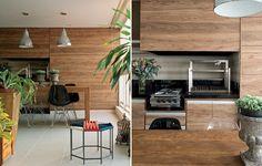 A varanda de 45 m² é também sala de jantar. Por isso, a churrasqueira é pequena, acompanhada por um fogão de duas bocas. A coifa é escondida por painel com laminado / Sartori Design
