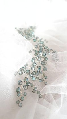 This beautiful handmade bridal hair piece made with sea green shiny crystals and silver wire. Complement most wedding hairstyles. It is the perfect bridal headpiece for beach wedding. ♥ Size approx 23 сm (9) ♥ Flexible and bendable ♥ ATTACHES: secures easily with the bobby pins (not