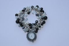 Black, White and Silver Watch-Bracelet, £10.00