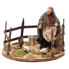 Donna con becchime movimento cm 14 presepe napoletano | vendita online su… Fontanini Nativity, Nativity Stable, Medieval Houses, Christmas Nativity Scene, Modelos 3d, Ceramic Houses, Fairy Doors, Flowering Trees, Diorama