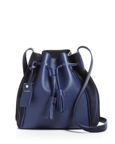 Sumptuous suede side panels and signature tassels showcase Longchamp's premium craftsmanship and Parisian chic on a breezy bucket bag. | Leather | Made in France | Adjustable shoulder strap | Drawstr