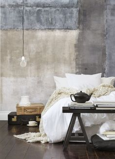 Love the look of this bedroom wall! Very industrial and cool, yet warm.