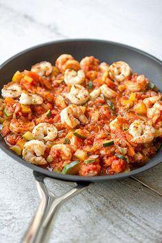 Scampi's met tomaten-groentensaus.