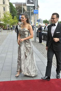 Exquisite gown worn by Crown Princess Victoria accompanied by Prince Daniel