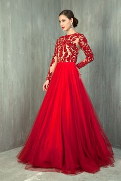Net gown embellished with three colors floral velvet applique