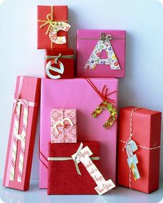 This is a cute way to wrap presents! Letters of different sizes and patterns + solid paper + yarn!