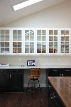 Kitchen, two tone cabinets and counter.
