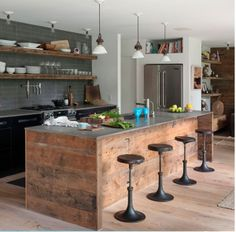 rustic contemporary kitchen with reclaimed wood island and open shelving