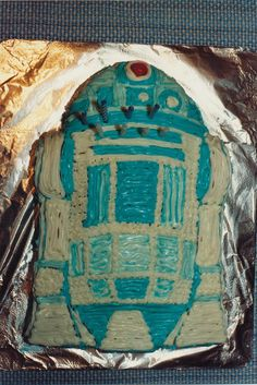 8th Plus in Birthday Cake Creations series: for a party, I made R2D2, I believe it's my only pre-fab (not original) - wow it's much easier to just fill in the lines. But where's the crazy fun?!